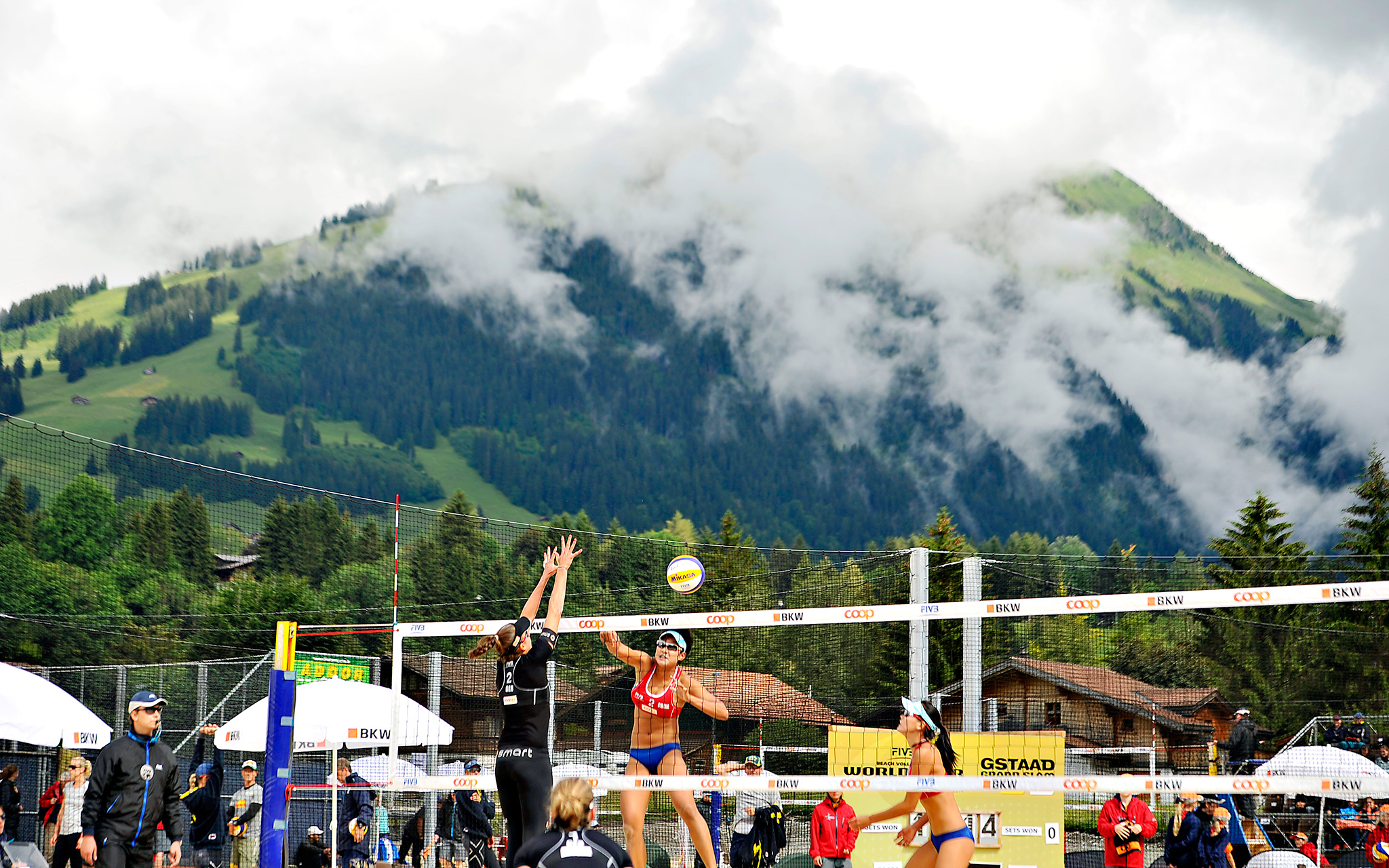 Germany's Ilka Semmler and Katrin Holtwick, left, compete against China's Xinyi Xia and Yuanyuan Ma during the second day of the FIVB Gstaad Grand Slam volleyball tournament in Switzerland.