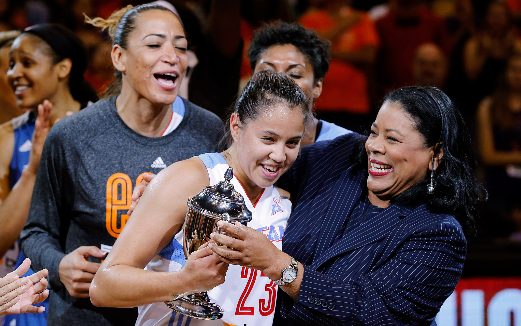 Atlanta's Shoni Schimmel, a rookie who doesn't even start for her own team, is given the MVP trophy by WNBA president Laurel J. Richie after putting on a record-breaking performance -- scoring 29 points to help the East beat the West 125-124 in overtime.