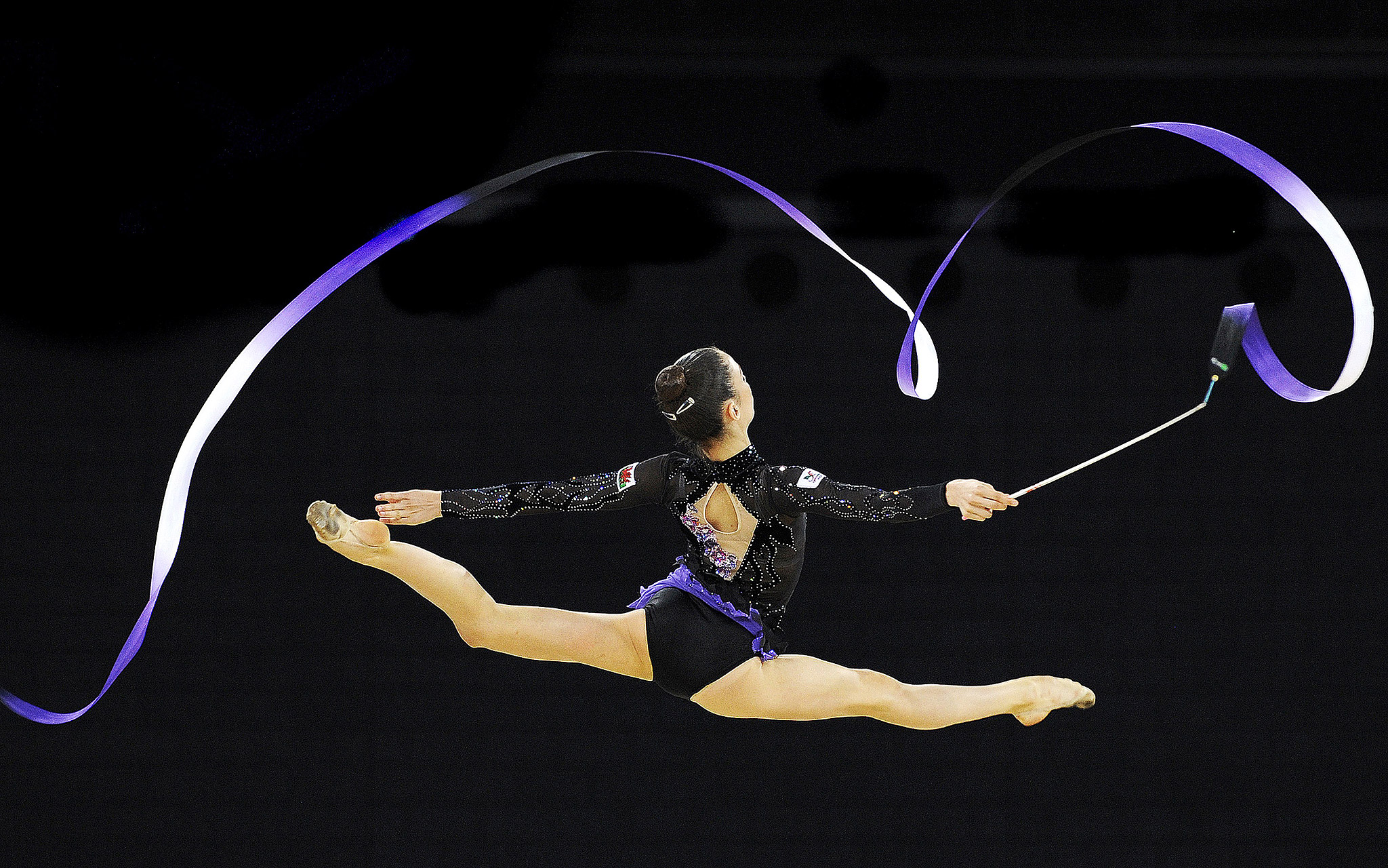 Wales' Laura Halford competes in the women's rhythmic gymnastics individual ribbon final at the Commonwealth Games in Glasgow, Scotland.