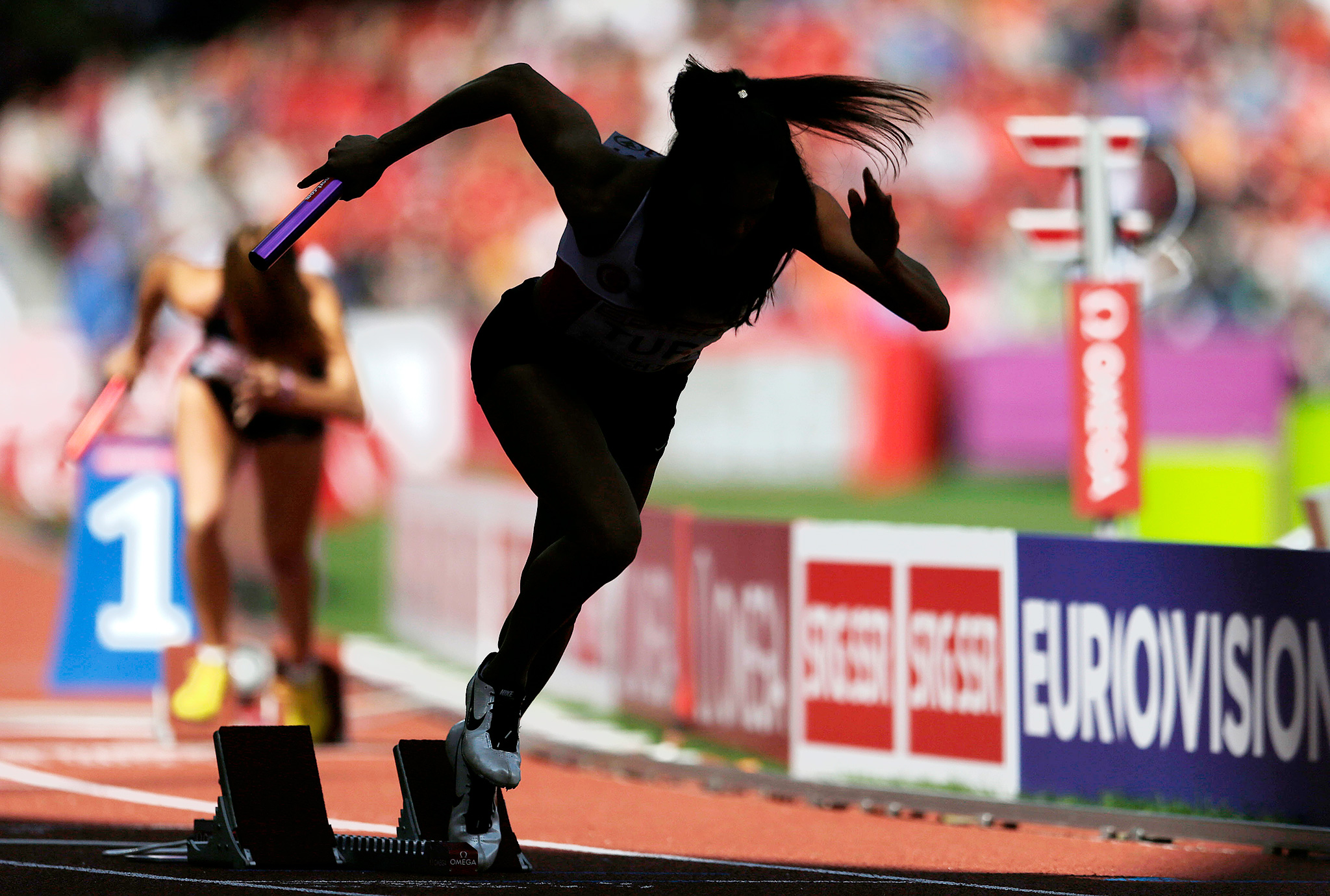 A runner starts in the women's 4x400-meter relay heat at the European athletics championships in Zurich, Switzerland.