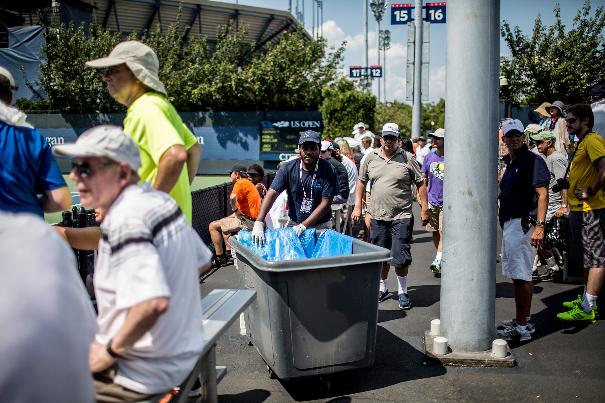 While silence is a staple of tennis etiquette, it was hard to come by on Court 15. At times, the rolling of a trash bin flooded the air during play. It was often louder than the applause from those in the stands.