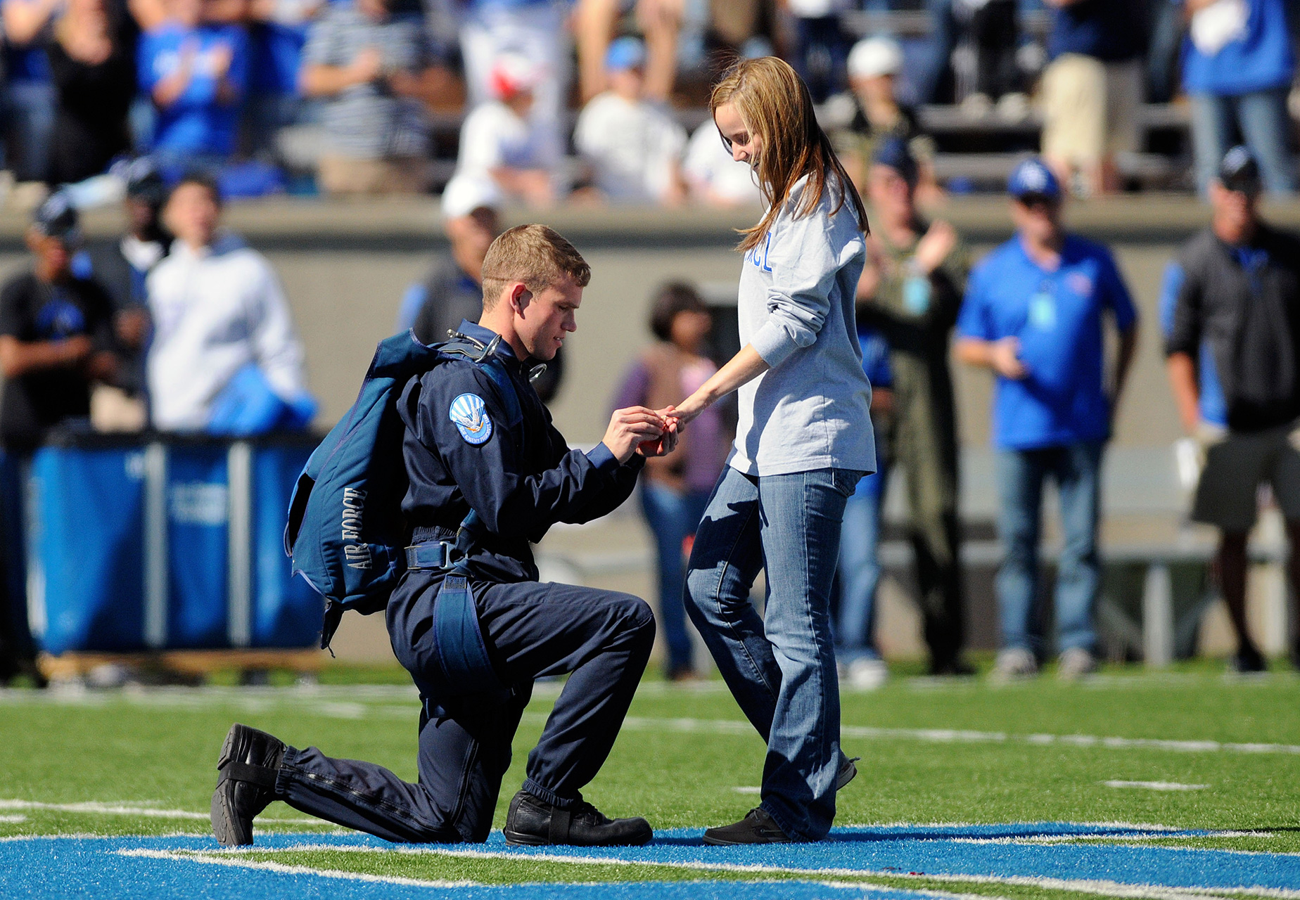 Talk about an entrance! After skydiving into Falcon Stadium ahead of a 2010 Air Force football game, a parachute jumper used his moment in the spotlight to ask THE question.