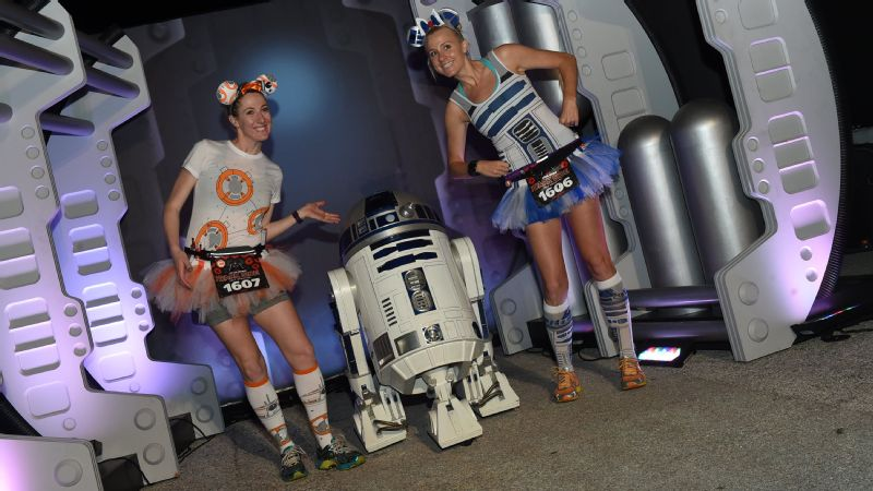 Droids stick together as BB-8 and R2D2 runners pose with the real droid himself during the Dark Side Half Marathon.