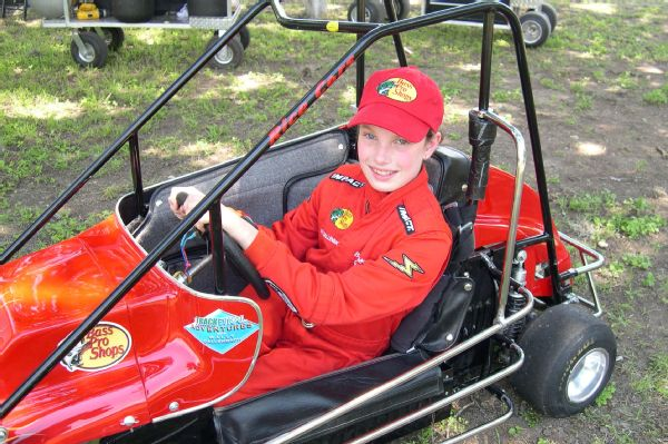 Kate Dallenbach takes the wheel of her quarter midget race car as a 9-year-old.