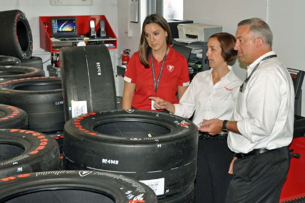 A big three with Firestone: senior project engineer Cara Adams (left), director Lisa Boggs (center) and chief engineer Dale Harrigle review tire data at Indianapolis Motor Speedway.