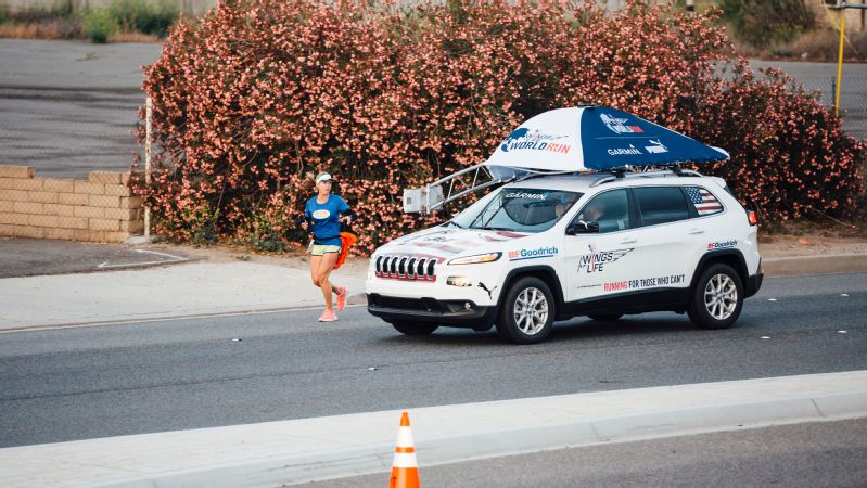 The catcher car catches up with a runner at the Wings For Life World Run event in Santa Clarita, California.