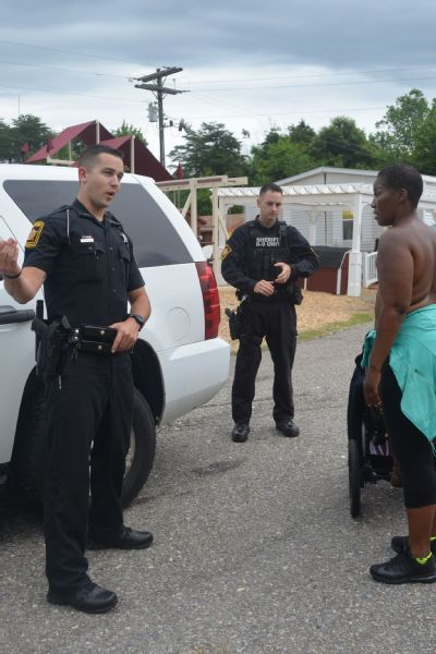 Deputies Pearce and Ridings of the Spotsylvania County Sheriff's Office stop Leaphart on June 24 to speak with her about her decision to walk topless.