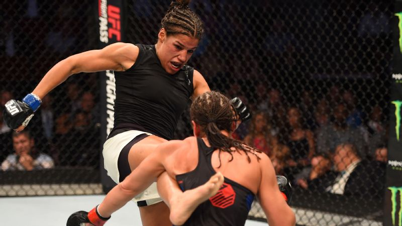 Julianna Pena kicks Jessica Eye in their women's bantamweight bout during the UFC 192 event at the Toyota Center on Oct. 3, 2015, in Houston, Texas.