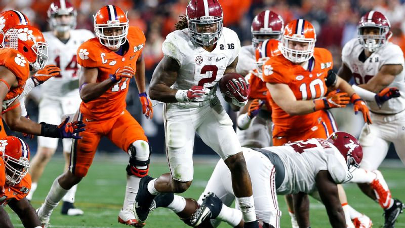 Running back Derrick Henry of the Alabama Crimson Tide breaks a few tackles on a running play during the College Football 2016 National Championship Game.
