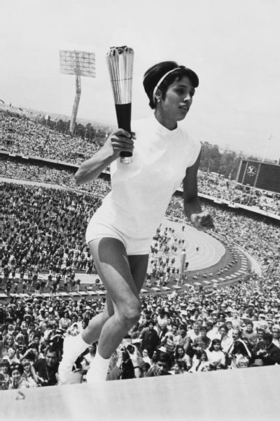 Enriqueta Basilio carries the Olympic torch during the 1968 Summer Olympics.