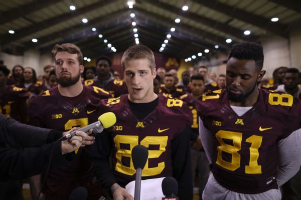 The University of Minnesota football team dropped its boycott and will play in the Holiday Bowl following the suspension of 10 players.