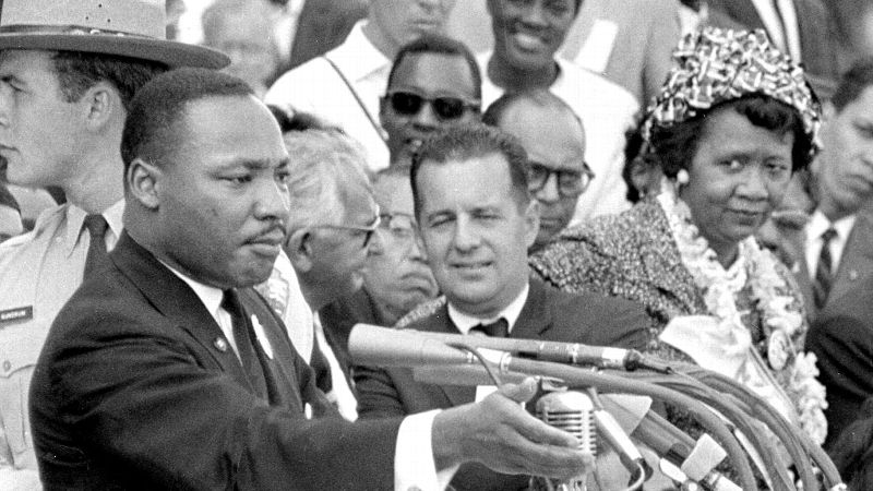 Dorothy Height, right, National President of the National Council of Negro Women and Director of the center for Racial Justice of the national YWCA, listens as the Rev. Dr. Martin Luther King Jr., gestures during his 1963 I Have a Dream speech.