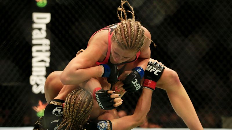 Herrig, bottom, lost to Paige VanZant over three rounds at UFC on FOX 15 in 2015.