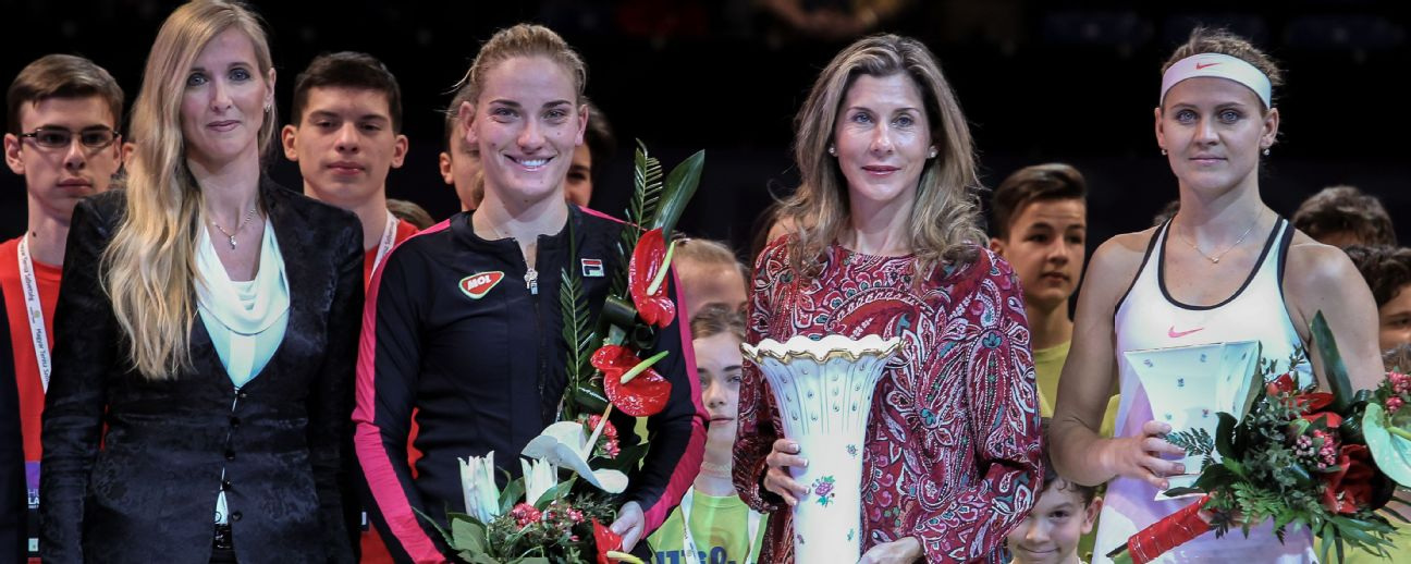 Winner Timea Babos (second from left) and runner-up Lucie Safarova (far right) have also been playing as doubles partners. The players are flanked by Dr. Tunde Szaba (far left) and Monica Seles.