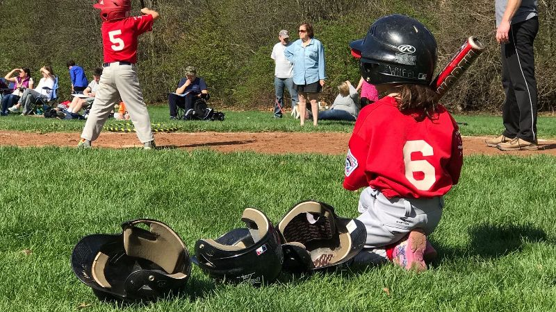 Seth Wickersham's daughter, Maddie, waits on deck in her first baseball game.