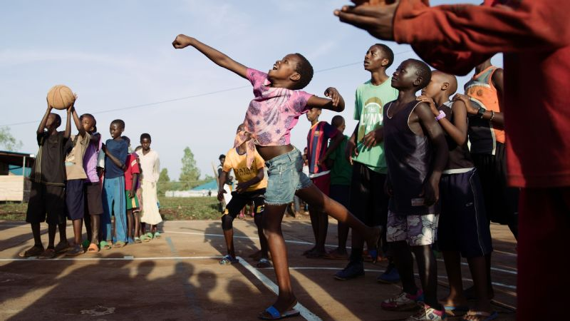 A young girl fires off a shot during a drill with nonprofit organization Shooting Touch, which uses basketball to promote health and wellness, in Nyamirama, Rwanda.