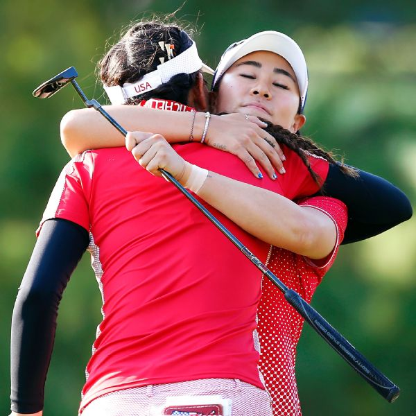 The United States' Danielle Kang, right, gets a hug from teammate Michelle Wie after their four-ball match victory in the Solheim Cup on Friday.