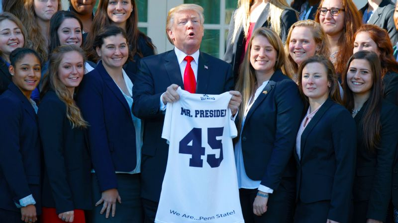 President Donald Trump poses with the Penn State women's rugby team at the White House. The Nittany Lions were one of 18 teams to have won an NCAA championship to visit Friday.