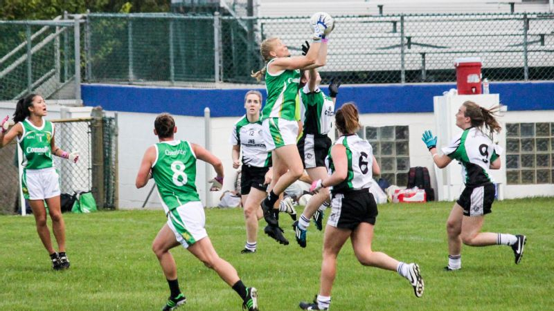 Annie Ruffino (jumping, in the center) at last year's national championship game in Gaelic football.