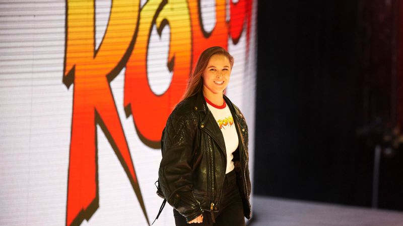 A new career in WWE has put a smile on Ronda Rousey's face.