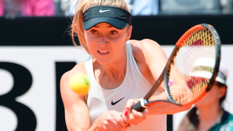 Ukraine's Elina Svitolina returns the ball to Romania's Simona Halep during the women's final at Rome's WTA Tennis Open tournament at the Foro Italico