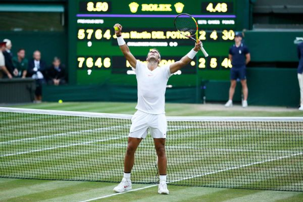 Rafael Nadal of Spain celebrates defeating Juan Martin Del Potro of Argentina in their men's quarterfinal match at the Wimbledon Tennis Championships in London, Wednesday July 11, 2018.