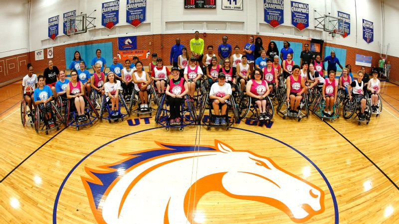 The Dallas Wings players and coaching staff with the women's wheelchair development camp.