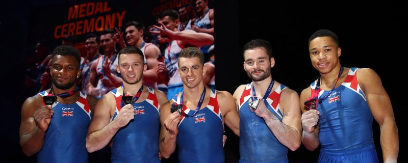 Courtney Tulloch, Dominick Cunningham, Max Whitlock, James Hall and Joe Fraser of Great Britain show off their silver medals in Glasgow.