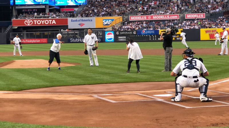 AAGPBL player Katie Horstman throws out the first pitch at Yankee Stadium.