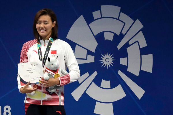 Women's 50-meter backstroke gold medalist China's Liu Xiang stands on the podium at the 18th Asian Games in Jakarta, Indonesia.