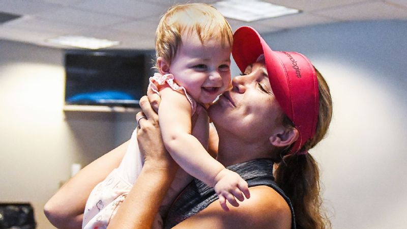 Golfer Sydnee Michaels uses the LPGA's childcare program for her 9-month-old baby Isla when she competes on tour, including in August at the Indy Women in Tech Championship.