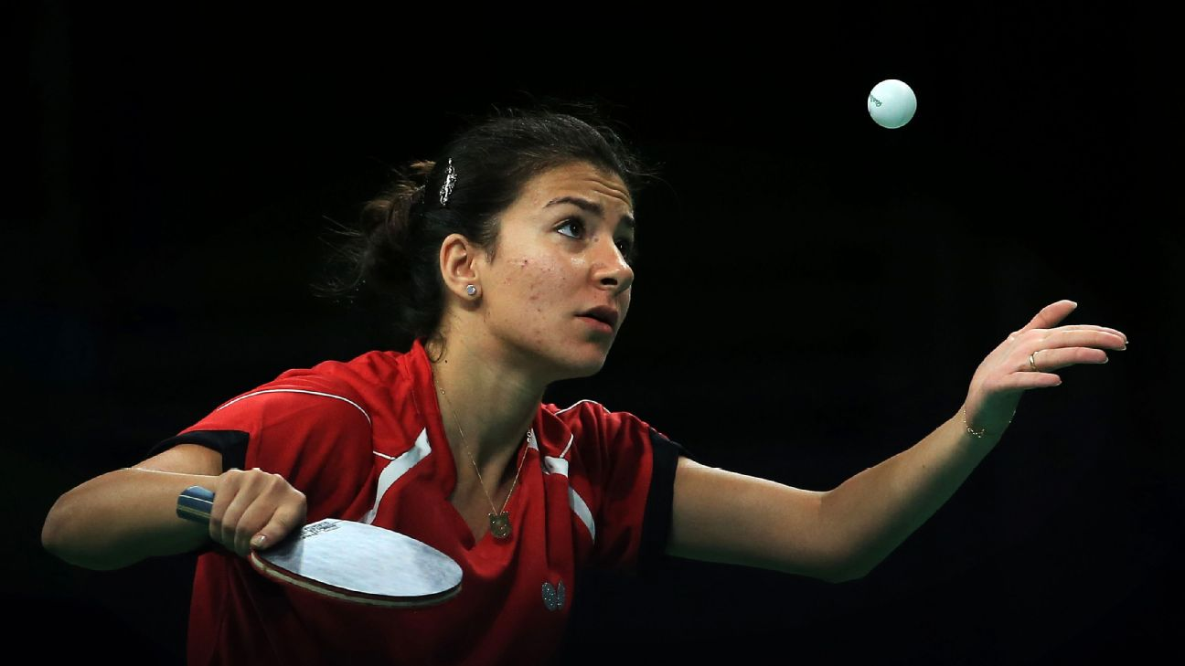 Dina Meshref of Egypt serves to Yu Mengyu of Singapore during the Rio 2016 Olympic Games. Meshref goes to the World Cup in China ranked 43 in the world.