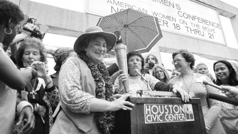 King with Bella Abzug, a former U.S. Representative and social activist, and other leaders at the National Women's Conference in Houston in 1977.