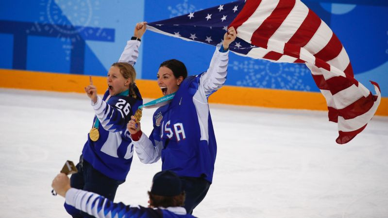 Kendall Coyne, left, Hilary Knight and the U.S. women's hockey team know their fight for equal pay and increased exposure doesn't end with a gold medal in the Olympics.