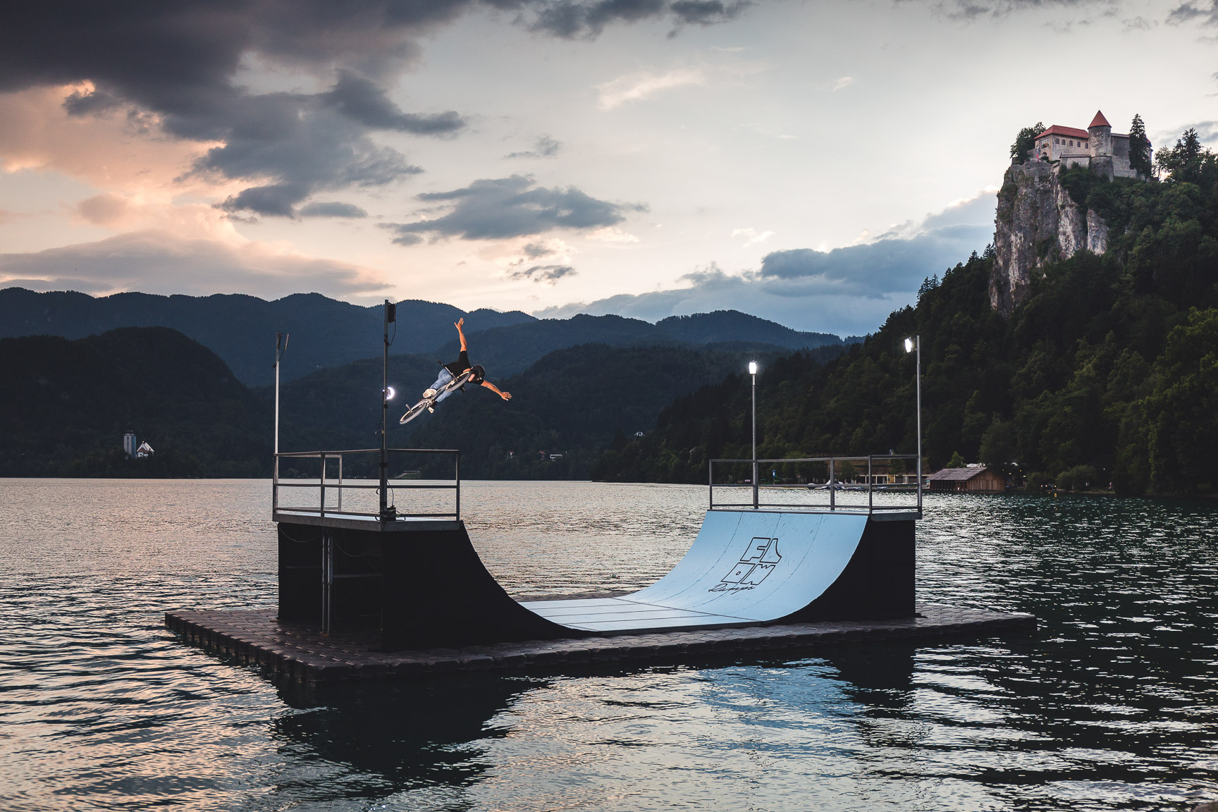 I got invited to shoot a Sunset Miniramp BMX Session at Lake Bled, Slovenia. I quickly realized that it is something special to shoot a floating ramp there. I have always wanted to go to Lake Bled to shoot a landscape photo, but to be able to combine it with BMX Rider Matej Zan and a miniramp made it even better. -- Hannes Mautner