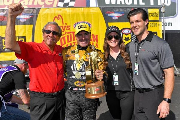 From left, team owner Don Schumacher, Funny Car driver Ron Capps, Megan Fessel-Schumacher and Chad Osier.