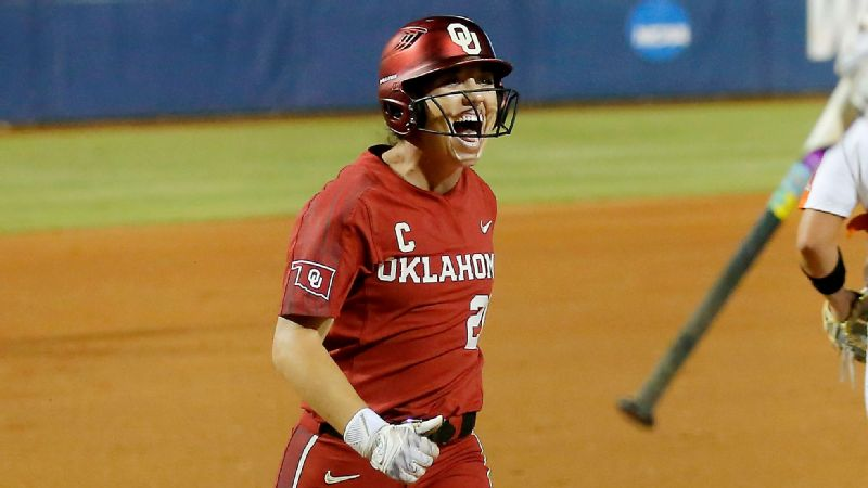 Caleigh Clifton celebrates during Oklahoma's three-run first inning Friday night at the Women's College World Series.