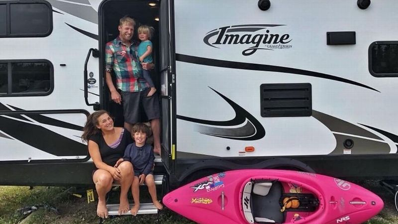 Emily Jackson with her husband, Nick Troutman, and their children, Parker (top) and Tucker (sitting), in their RV.