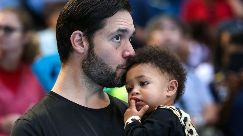 Alexis Ohanian holds daughter Alexis Olympia while watching his wife -- and her mom -- Serena Williams play in the 2019 Hopman Cup in January.