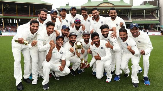 The Indian players pose with the Border-Gavaskar Trophy David Gray/AFP/Getty Images