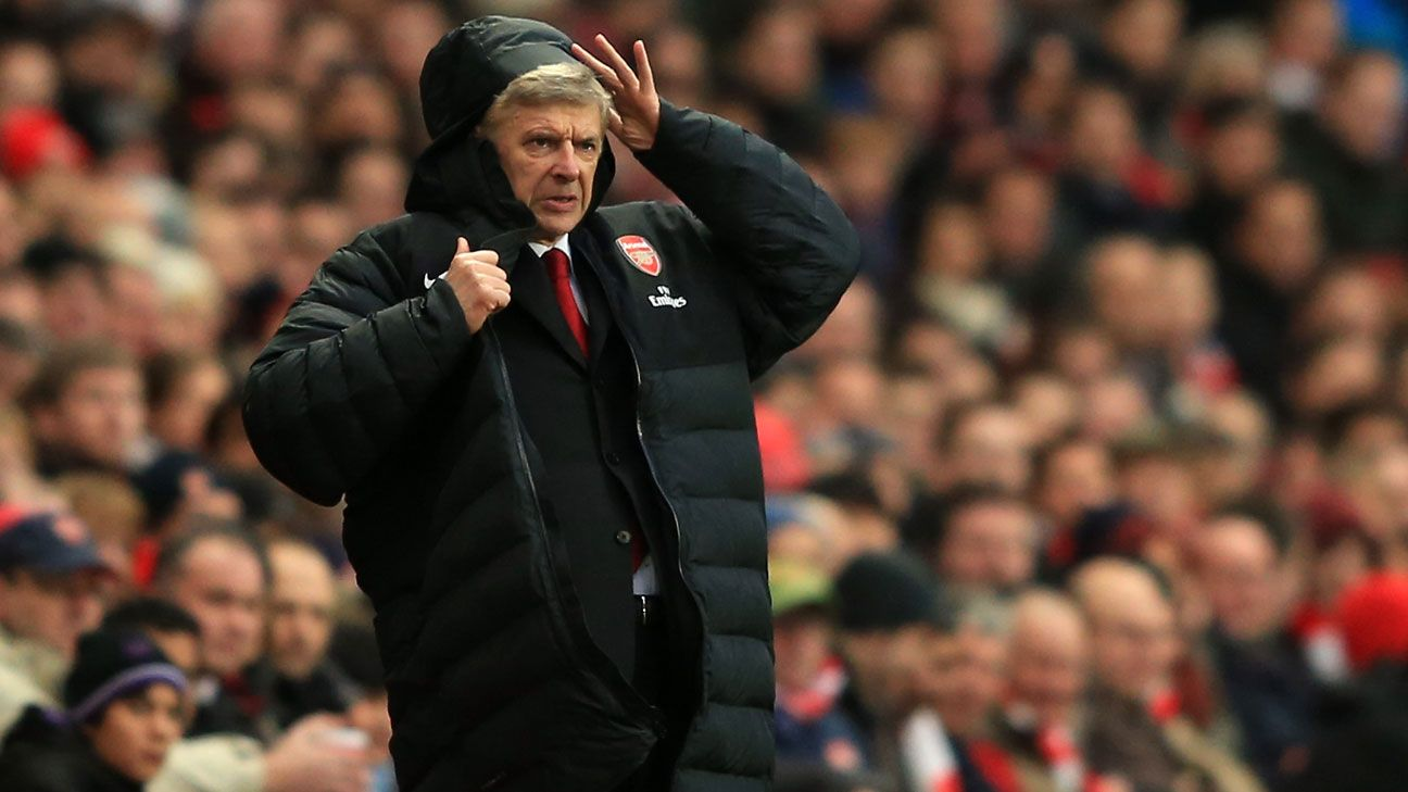 b0e1e33cf Arsene Wenger given new 'easy-zip' coat to combat mishaps