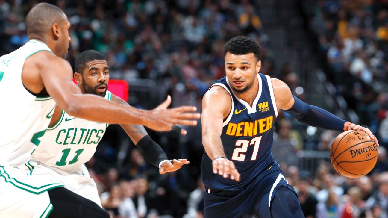 95c1cd335995 Kyrie Irving of Boston Celtics cries foul over Jamal Murray s shot at end  for 50
