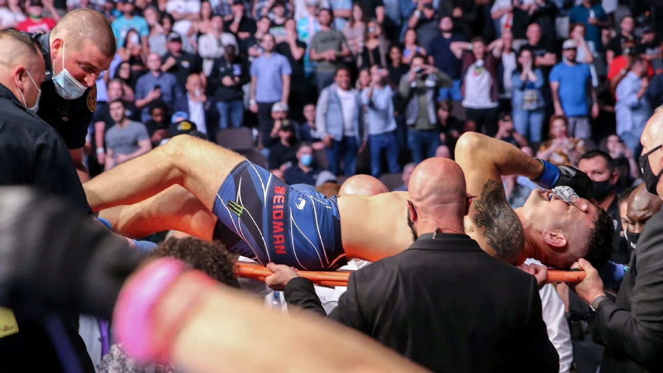 Weidman carted off after leg snaps in Hall bout thumbnail