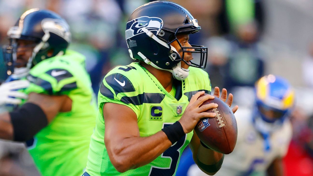Status of injured Seattle Seahawks quarterback Russell Wilson to be determined by hand specialist