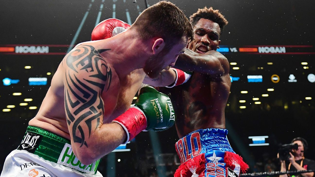 Jermall search Los stop Dennis Hogan in the 7th round to retain the title