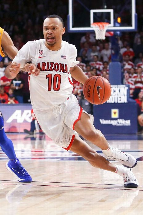 Arizona Wildcats guard Jemarl Baker Jr. (10) dribbles the ball against San Jose State Spartans guard Richard Washington (22) in the second half at McKale Center