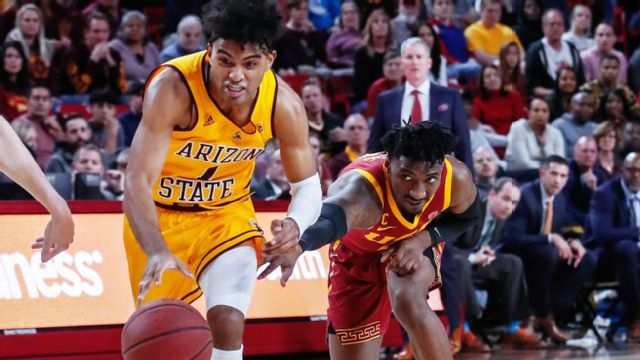 Arizona State Sun Devils guard Remy Martin (1) dribbles the ball by USC Trojans guard Jonah Mathews (2) during the college basketball game between the USC Trojans and the Arizona State Sun Devils on Feb. 8, 2020, at Desert Financial Arena in Tempe, Arizona.
