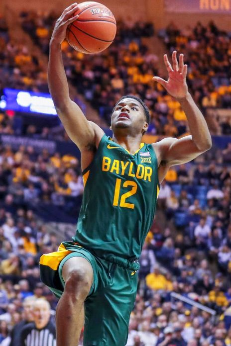 Baylor Bears guard Jared Butler (12) drives down the lane and shoots during the first half against the West Virginia Mountaineers at WVU Coliseum