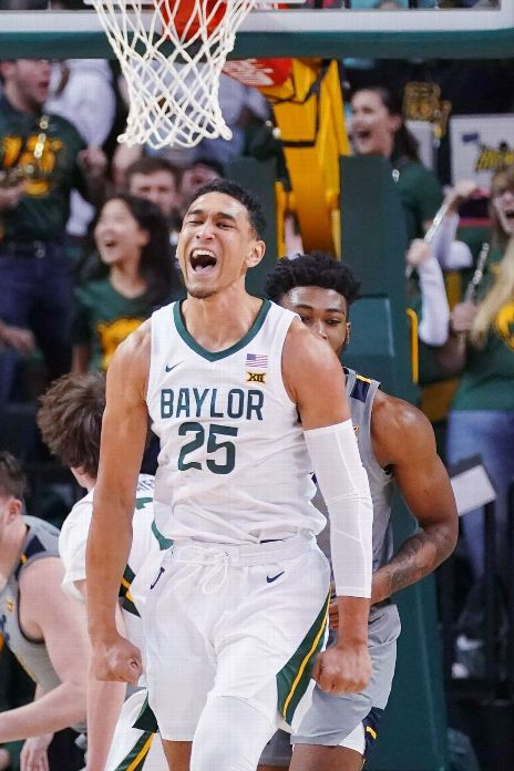 Baylor Bears forward Tristan Clark (25) reacts to a dunk by Baylor Bears guard Matthew Mayer (not pictured) against the West Virginia Mountaineers during the first half at Ferrell Center