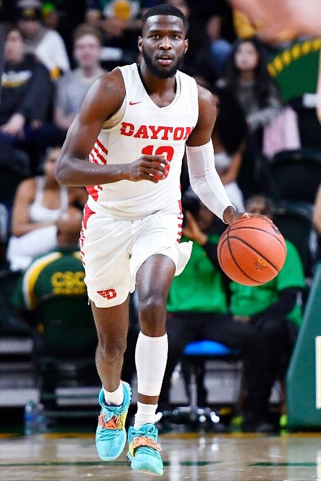Dayton Flyers guard Jalen Crutcher (10) advances the ball against the George Mason Patriots during the first half at EagleBank Arena